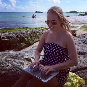 Kristin Wilson working with the ocean at her back in Mexico – Best Places In The World To Retire – International Living